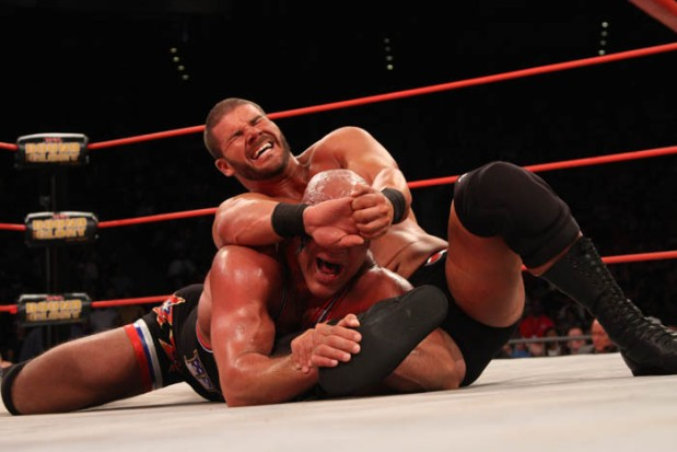 Bobby Roode utilizes the crossface against Kurt Angle.